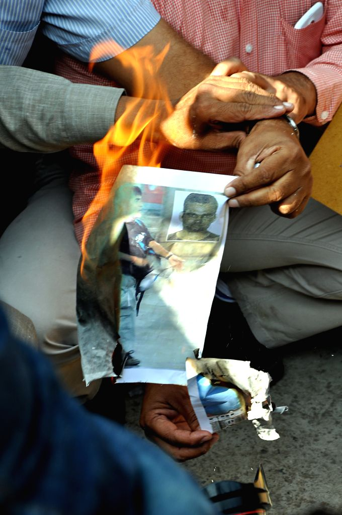 Ahmedabad, Gujarat, India, Wednesday, 21 Nov, 2012,  Citizen groups in the city welcomed the hanging of Amir Ajmal Kasab, the only surviving assailant in Mumbai terror attack of 2008 and celebrated by distributing sweets and bursting firecrackers. A