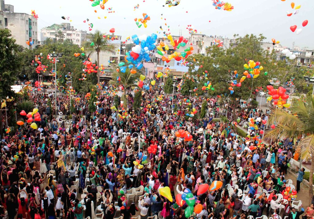 People release balloons in the air as they welcome 2015 in Ahmedabad.