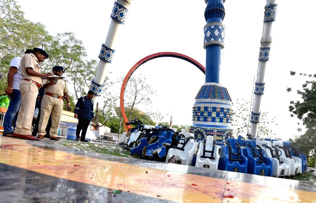 Ahmedabad: Police personnel inspects the site where at least three persons were killed and as many as 31 others injured when an amusement ride collapsed at the public park around the sprawling Kankaria Lake, in Ahmedabad on July 14, 2019. (Photo: IAN