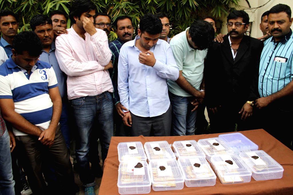 Police presents people who were held with 60 kg gold at the Sardar Vallabhbhai Patel International Airport in Ahmedabad, on Feb 24, 2015.