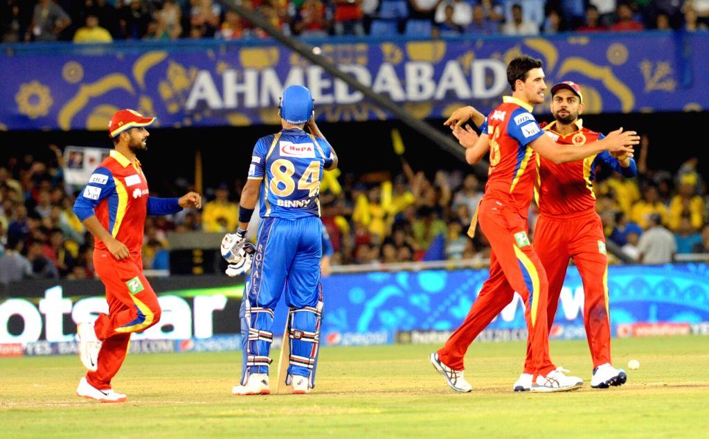 Royal Challengers Bangalore players celebrate fall of a wicket during an IPL-2015 match between Royal Challengers Bangalore and Rajasthan Royals at Sardar Patel Stadium, Motera, in ... - Ajinkya Rahane and Sardar Patel Stadium