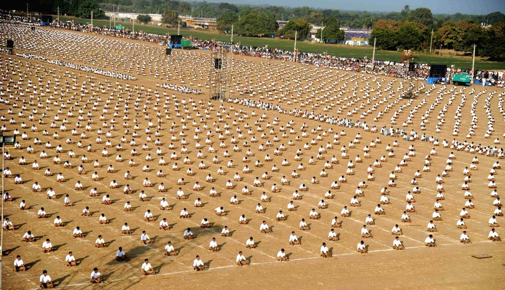 RSS workers perform `Surya Namaskar` - Sun Salutation -  during the concluding session of the three-day long 'Karyakarta Shivir` in Ahmedabad, on Jan 4, 2015.