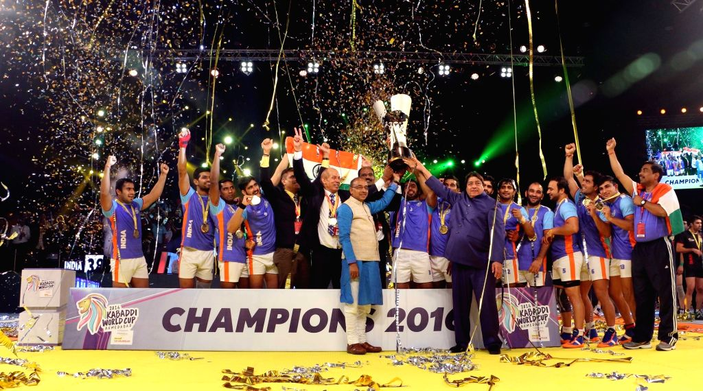 Ahmedabad: Team India with 2016 Kabaddi World Cup trophy during presentation ceremony after winning the final match against Iran in Ahmedabad on Oct 22, 2016. Also seen  Minister of State for Youth Affairs and Sports (I/C), Water Resources, River Dev