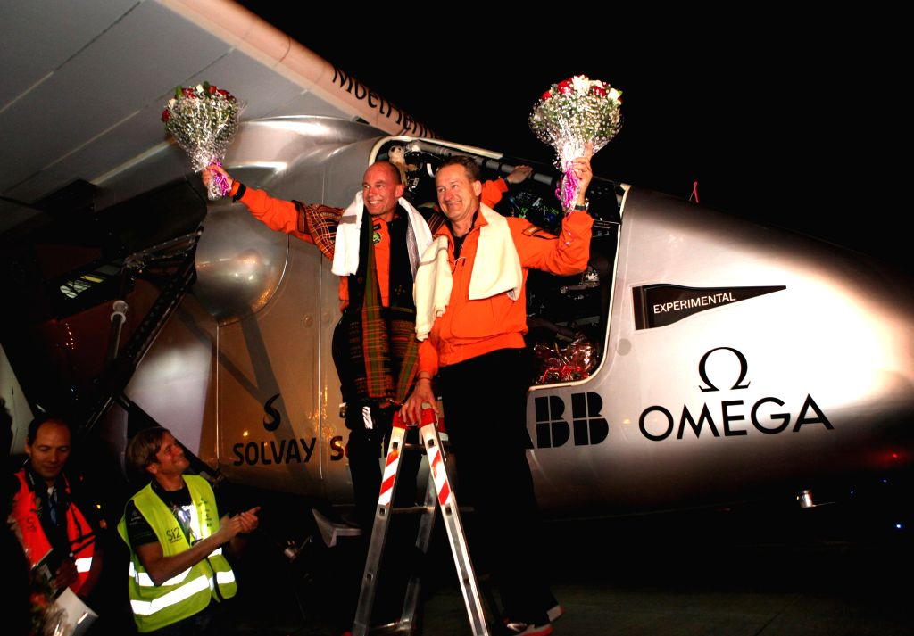 The pilot and the co-pilot of Solar Impulse 2,  Bertrand Piccard (R) and Andre Borshberg (L) after landing at  Sardar Vallabhbhai Patel International Airport in Ahmedabad, on March 10, ...