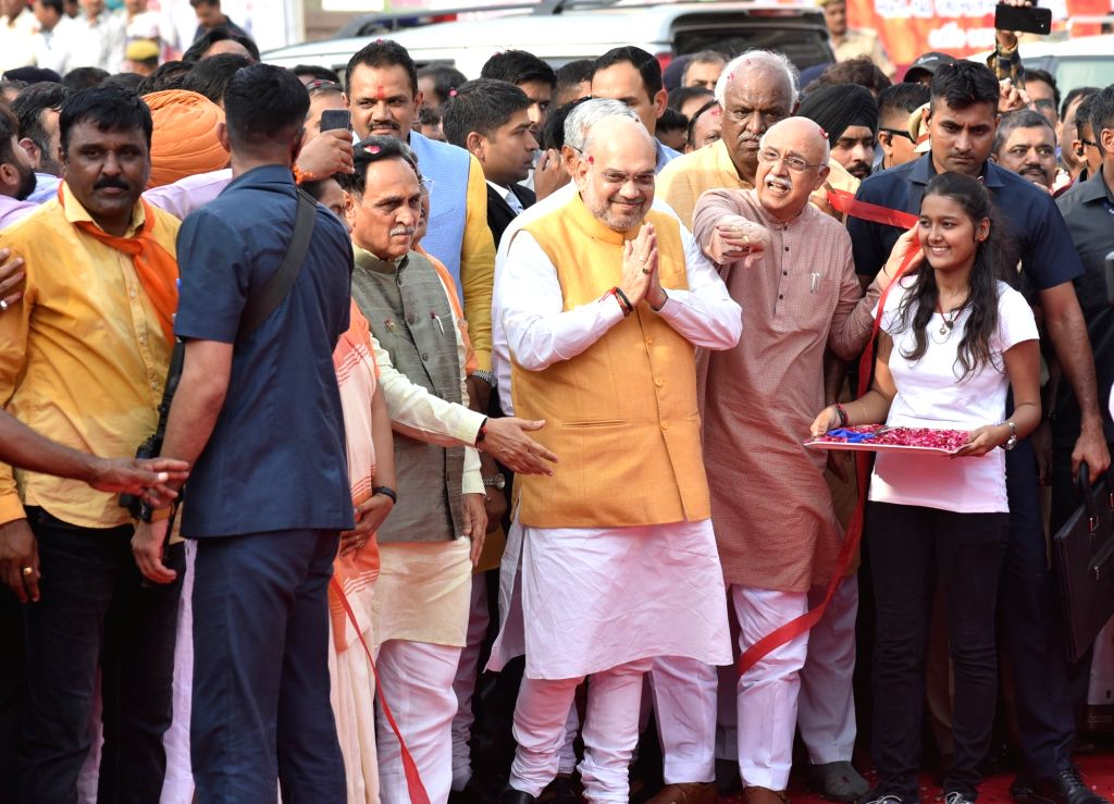Ahmedabad: Union Home Minister Amit Shah with Gujarat Chief Minister Vijay Rupani at the inauguration of the Income Tax Flyover between Ashram Road and D.K. Patel Hall in Ahmedabad, on July 3, 2019. (Photo: IANS) - Amit Shah and K. Patel Hall