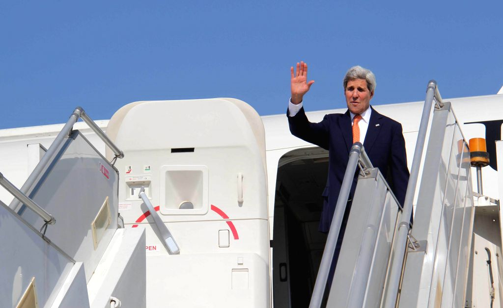 US Secretary of State John Kerry waves before his departure from Ahmedabad on Jan 12, 2015.