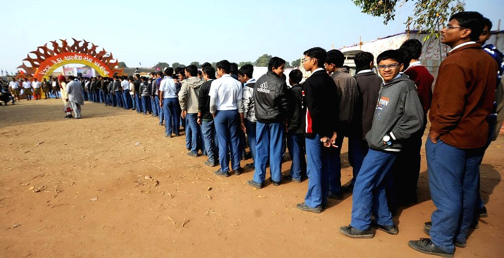 Volunteers of  Rashtriya Swayamsevak Sangh (RSS), arrive for a three-day long camp in Ahmedabad. More than 25,000 volunteers from across Gujarat are expected to participate in the camp.