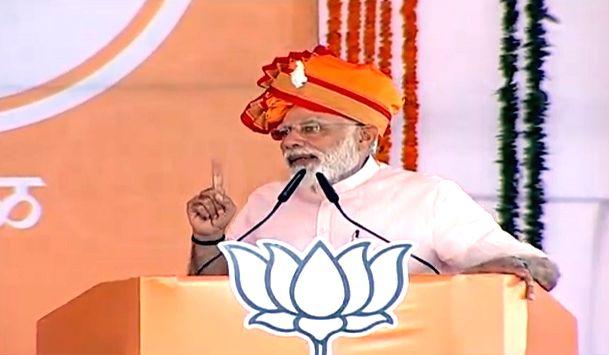 Ahmednagar: Prime Minister Narendra Modi addresses a public rally in Ahmednagar, Maharashtra, on April 12, 2019. (Photo: IANS) - Narendra Modi