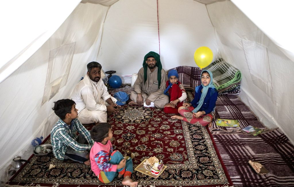 AHVAZ, April 9, 2019 - A family sit in a tent at a temporary camp after a flood just outside Ahvaz city, southwestern Iran, April 8, 2019. The unprecedented floods across Iran over the past weeks ...