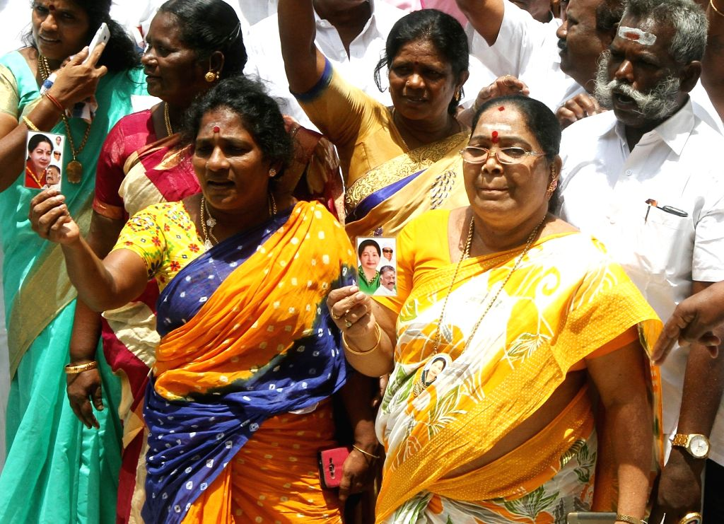 AIADMK workers at the party's headquarters after the O. Paneerselvam and K. Palaniswami factions of the party merged in Chennai on Aug 21, 2017.