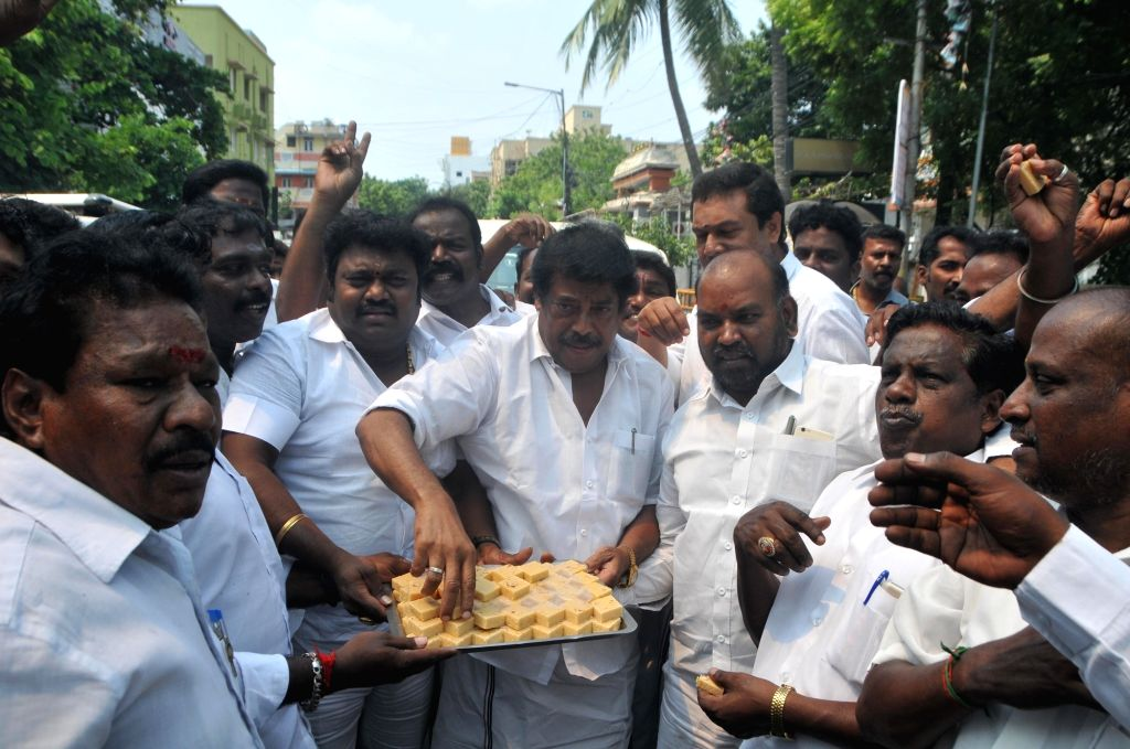 AIADMK workers celebrate after the Madras High Court upheld Tamil Nadu Assembly Speaker P. Dhanapal's 2017 decision of disqualifying 18 dissident AIADMK legislators; at the party office in ... - P. Dhanapa