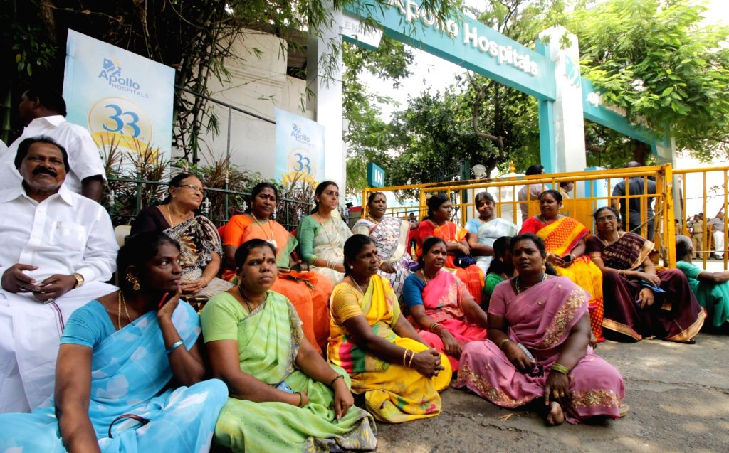 AIADMK workers wait outside the Apollo Hospital for updates about Tamil Nadu Chief Minister J Jayalalithaa in Chennai on Oct 6, 2016. - J Jayalalithaa