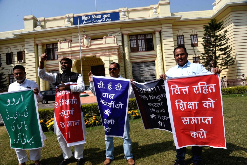 AIMIM legislators stage protest at Bihar Assembly during an ongoing budget session, in Patna on Wednesday 03rd March, 2021.