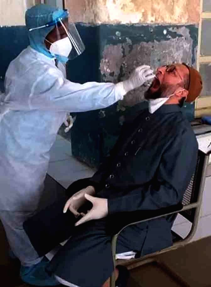 AIMIM president and Hyderabad MP Asaduddin Owaisi gives swab samples for COVID-19 testing at Government Nizamia General Hospital near the historic Charminar in Hyderabad on July 11, 2020. ...