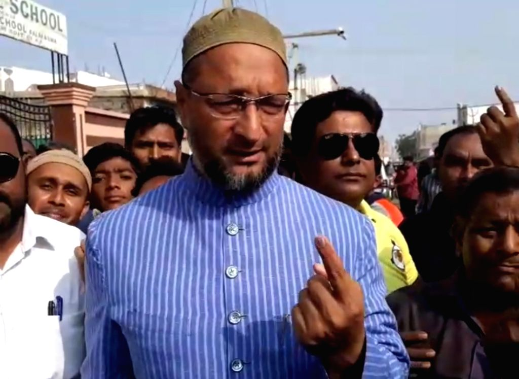 AIMIM president Asaduddin Owaisi shows his inked finger after casting his vote for Telangana Assembly elections in Hyderabad, on Dec 7, 2018.