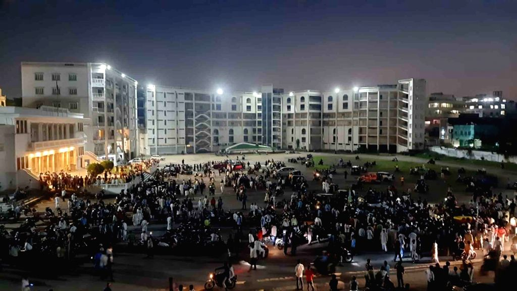 AIMIM workers celebrate the party's performance in the GHMC elections with firecrackers at the party's headquarters Darussalam, in Hyderabad on Dec 4, 2020. Results have been declared for ...