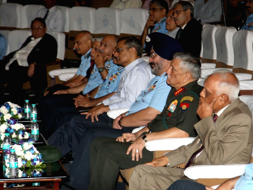 Air Chief Marshal B.S.Dhanoa, Army Chief General Bipin Rawat and other dignitaries during a a seminar organised to mark the 20th anniversary of Operation Safed Sagar, in New Delhi on July ...