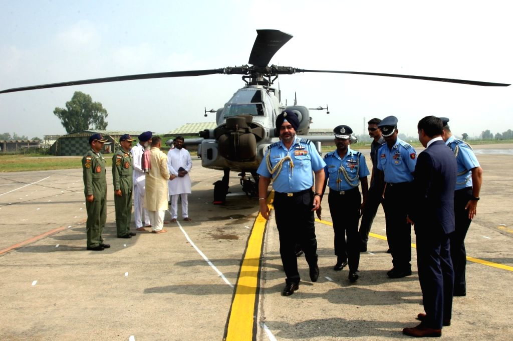 Air Chief Marshal Birender Singh Dhanoa during a programme where eight Apache helicopters were inducted into the the Indian Air Force (IAF) at the Pathankot Air Base in Punjab on Sep 3, ...