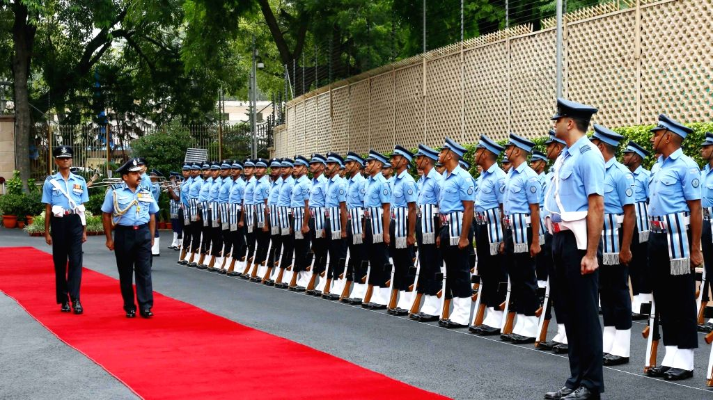 Air Chief Marshal Rakesh Kumar Singh Bhadauria inspects the Guard of Honour at Air Headquarters - Vayu Bhavan as he takes over as the 26th Chief of the Air Staff, in New Delhi on Sep 30, ...