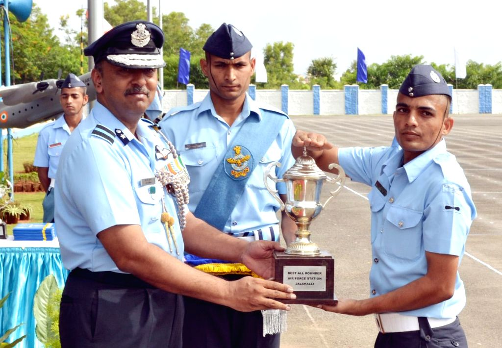 """Air Commodore CK Kumar presents the """"Best All Rounder Trophy"""" to leading aircraftman Rakesh Kumar, Electrical Fitter, passing out parade of trainees of Joint Basic Phase Training Intake and - Rakesh Kumar"""
