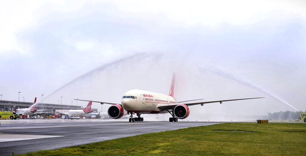 Air India's Non Stop flight from Delhi receives water salute at Washington Dulles International Airport in Virginia on July 7. 2017.