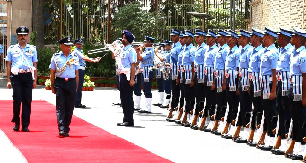 Air Marshal Anil Khosla PVSM AVSM VM ADC, Vice Chief of the Air Staff  inspects the Guard of Honour at Air Headquarters (Vayu Bhavan) as he retires after an illustrious career spanning ...