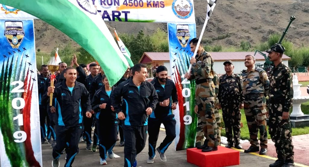 Air Officer Commanding, Jammu and Kashmir Air Vice Marshal Pankaj Mohan Sinha flags off Kargil to Kohima (K2K) Ultra-Marathon- ???Glory Run??? at Kargil War Memorial in Drass, Kargil on Sep ...