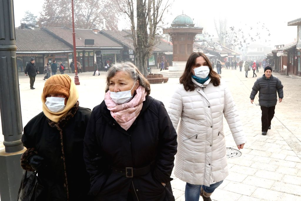 Air Pollution: People walk on the streets of Sarajevo - the capital of Bosnia and Herzegovina wearing masks so as to avoid breathing polluted air.  (File Photo: Xinhua/Haris Memija/IANS)