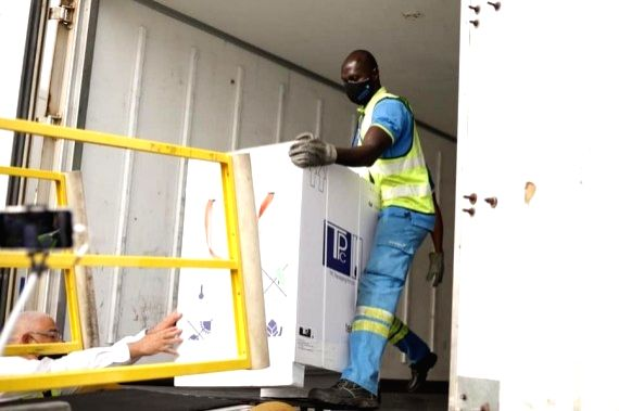 Airport workers unload COVID-19 vaccines at the Kotoka International Airport in Accra, capital of Ghana, Feb. 24, 2021.