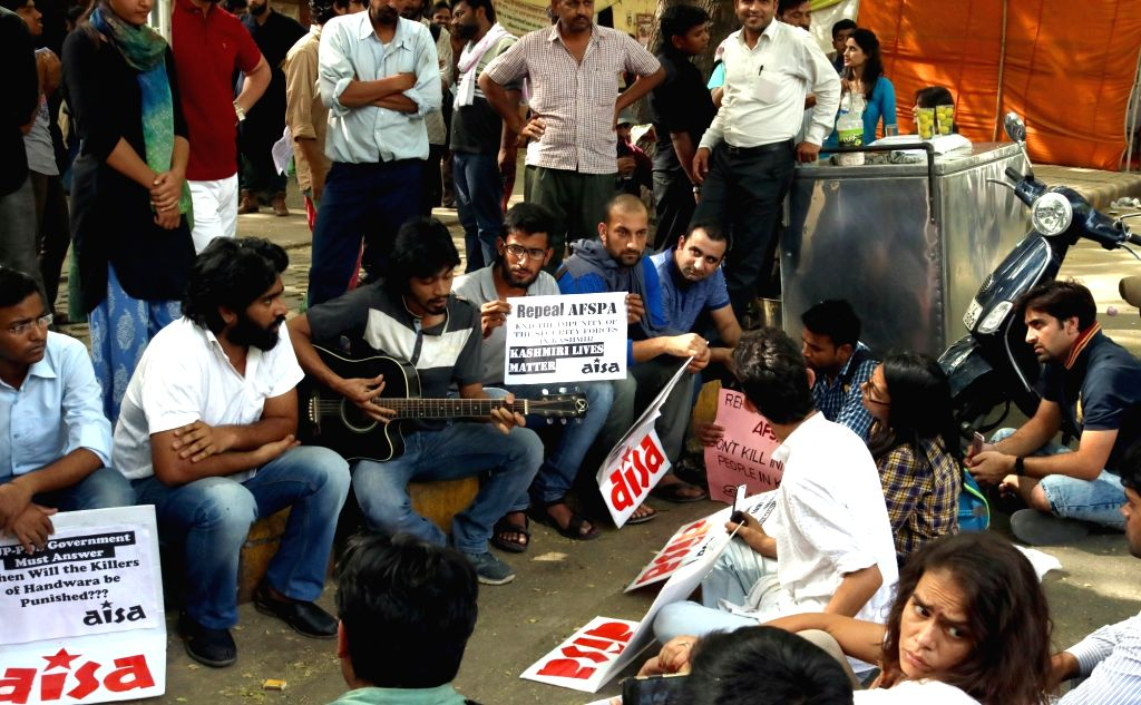 AISA activists stage a demonstration against lathicharge on NIT Srinagar students at Jantar Mantar, in New Delhi on April 16, 2016.