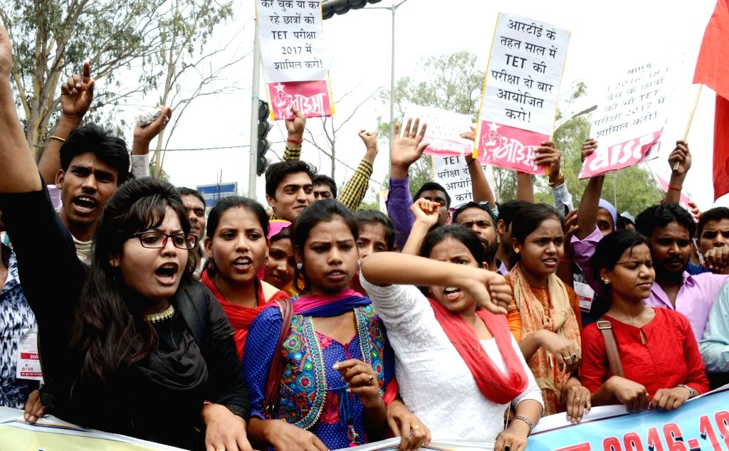 AISA activists stage a demonstration to press for their demands in Patna on April 21, 2017.