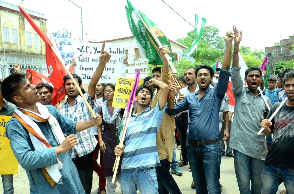 AISF activists stage a demonstration outside Patna University Vice Chancellor Prof. YC Simhadri's residence in Patna, on May 24, 2016.