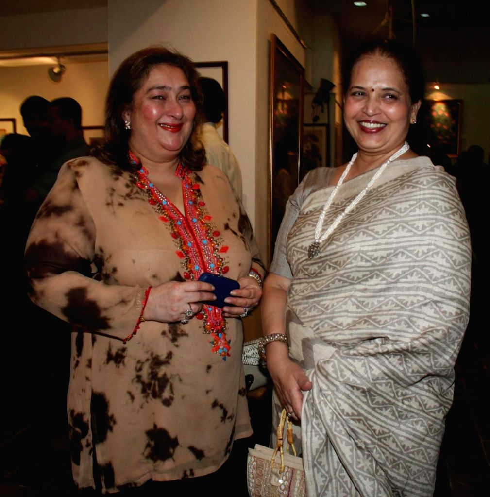 Aishwarya Rai Bachcham's mother Vrinda Rai with a guest at the Harmony Art show hosted by Tina Ambani at Chhatrapati Shivaji Maharaj Vastu Sangrahalaya's Coomaraswamy Hall in Mumbai Friday. - Aishwarya Rai Bachchams