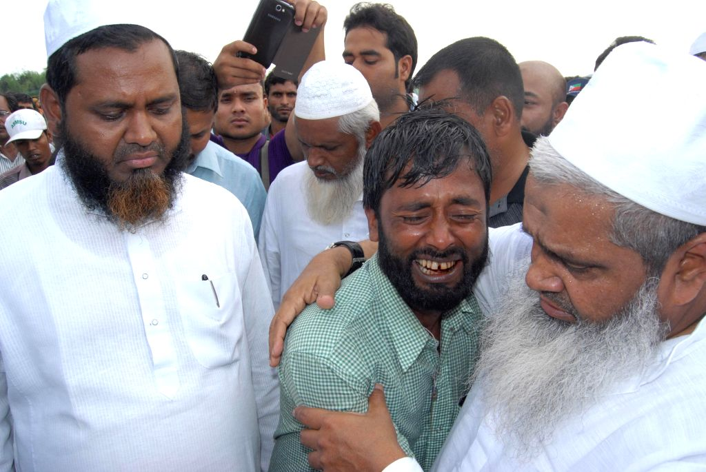AIUDF chief Badrudin Ajmal consoles a man during his visit to NarayanguriRelief Camp setup to provide shelter to those who fled their villages after recent violence in Bodoland Territorial Area ...