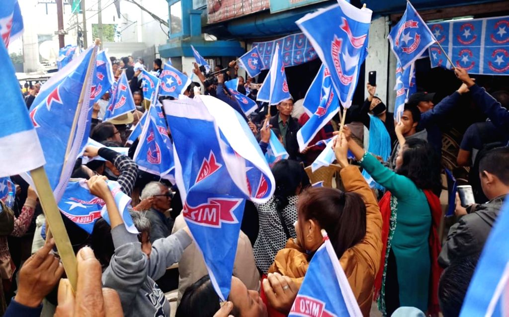 :Aizawl: Mizo National Front (MNF) workers celebrate party's performance in the recently concluded assembly polls in Aizawl, Mizoram on Dec 11, 2018. The party is all set to storm back to ...