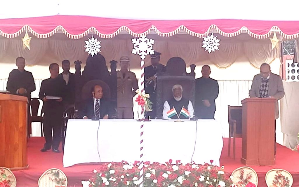 :Aizawl: Mizoram Governor Kummanam Rajasekharan administers the oath of office to Mizo National Front (MNF) leader Zoramthanga as the Chief Minister of Mizoram, in Aizawl on Dec 15, 2018. (Photo: ...