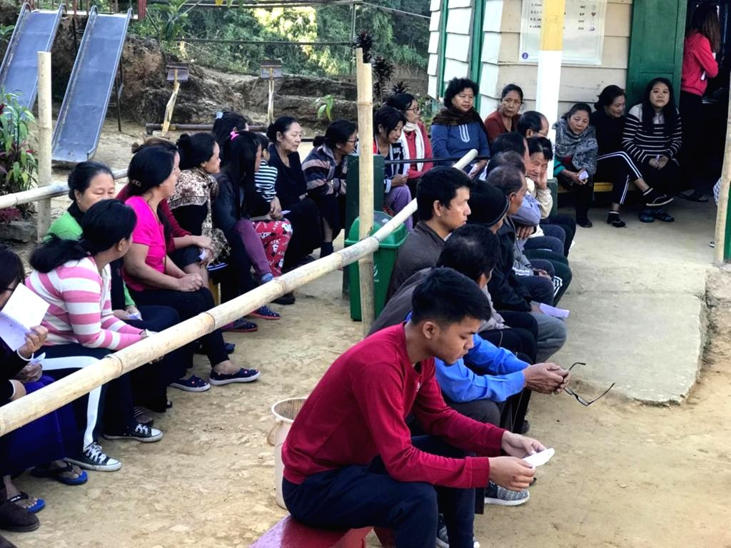 Aizawl, Mizoram: People wait to cast their vote for Mizoram assembly elections in Aizawl, Mizoram on Nov 28, 2018. (Photo: IANS)