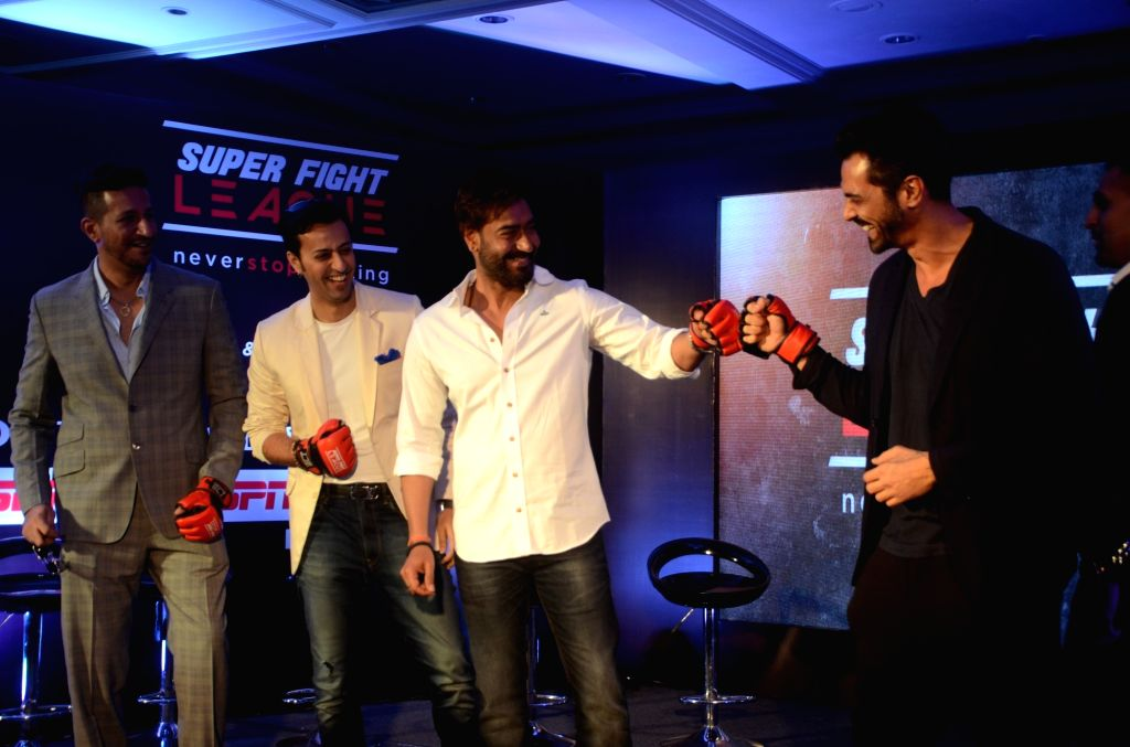 Ajay Devgan and Arjun Rampal during  a Super Fight League programme in Mumbai, on Jan 13, 2017 Super Fight League is a Mixed Martial Arts competition. - Ajay Devgan and Arjun Rampal