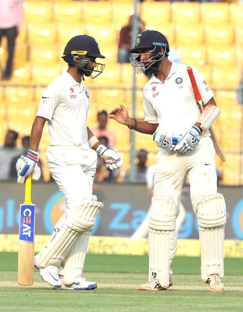 Ajinkya Rahane and Cheteshwar Pujara of India in action during the third day of the second test match between India and Australia at M. Chinnaswamy Stadium in Bengaluru on ​March 6, 2017.