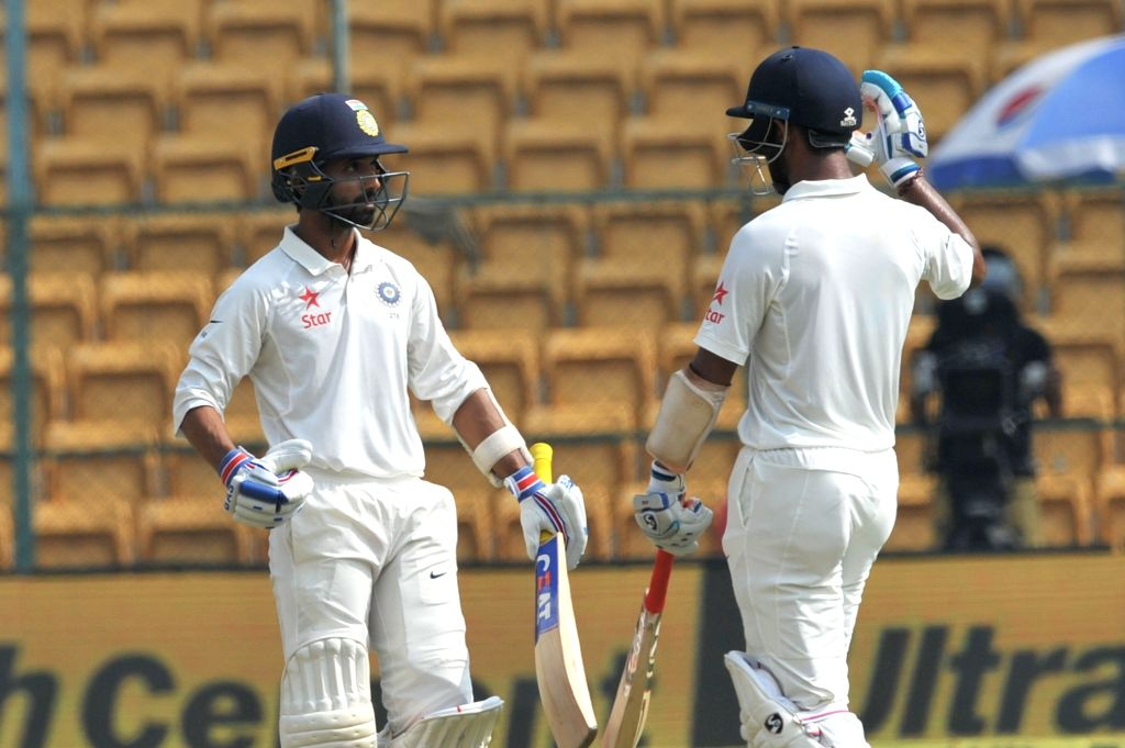 Ajinkya Rahane of India celebrates his half century during the fourth day of the second test match between India and Australia at M. Chinnaswamy Stadium in Bengaluru on March 7, 2017. ...