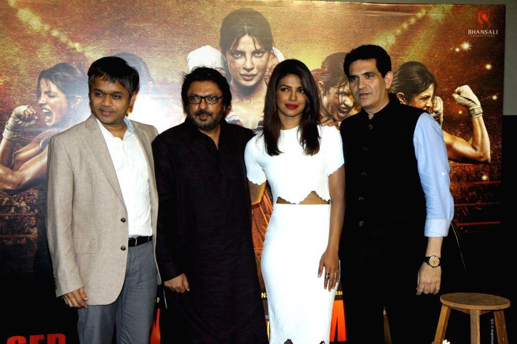 Ajit Andhare, Viacom 18 CEO, filmmaker Sanjay Leela Bhansali, actor Priyanka Chopra and filmmaker Omung Kumar during the unveiling of the trailer of film Mary Kom in Mumbai on July 23, 2014. - Priyanka Chopra and Omung Kumar