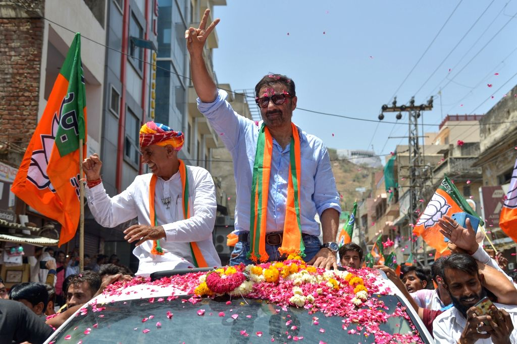 Ajmer: Actor and BJP leader Sunny Deol with the party's Lok Sabha candidate from Ajmer, Bhagirath Choudhary during a roadshow ahead of the 2019 Lok Sabha elections, in Rajasthan's Ajmer on April 27, 2019. (Photo: Shaukat Ahmed/IANS) - Bhagirath Choudhary