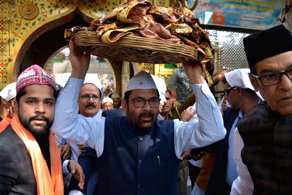 Ajmer: Union Minority Affairs Minister Mukhtar Abbas Naqvi arrives at Sufi Saint Khwaja Moinuddin Chishti's shrine, to offer the ceremonial 'chadar' on behalf of Prime Minister Narendra Modi in Ajmer, on March 6, 2019. (Photo: IANS) - Mukhtar Abbas Naqvi and Narendra Modi