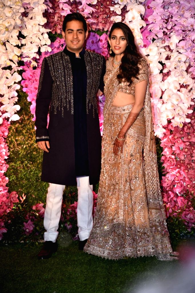 Akash Ambani and Shloka Mehta Ambani during their wedding reception at Jio World Garden in Mumbai on March 10, 2019. - Akash Ambani and Shloka Mehta Ambani