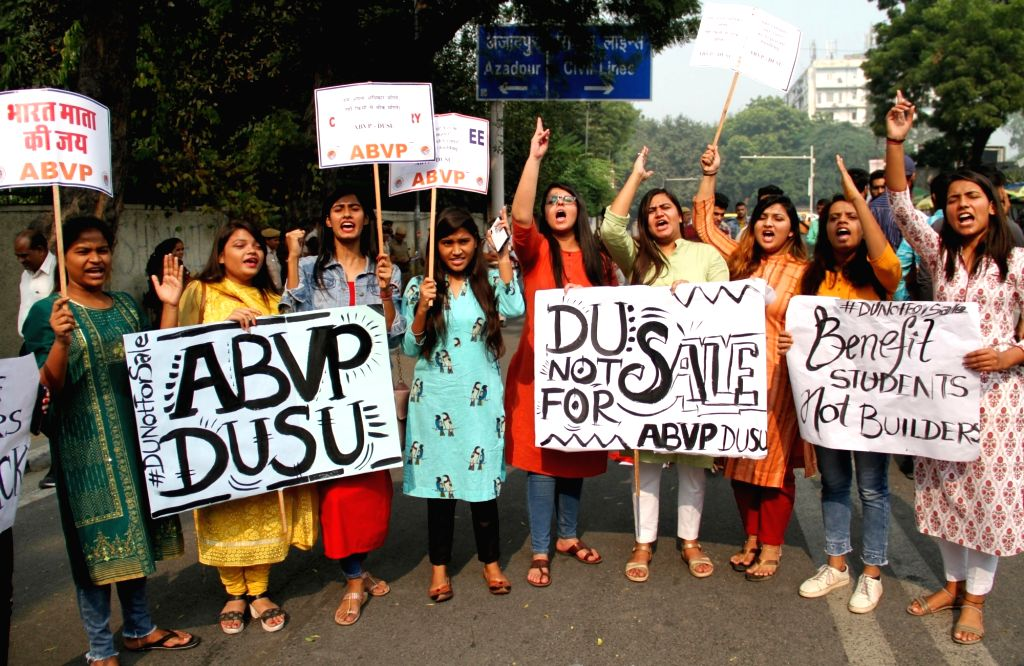 Akhil Bharatiya Vidyarthi Parishad (ABVP) members stage a demonstration against the proposed construction of a 39-storey building near North Campus, in New Delhi on Nov 12, 2019.