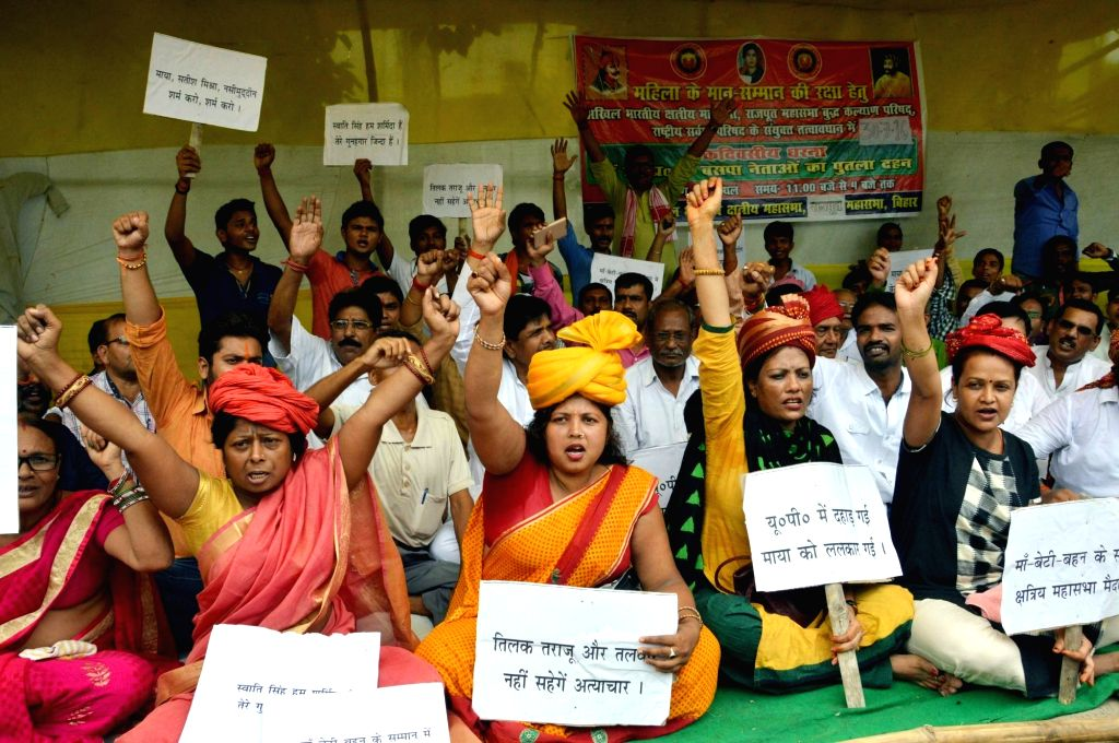 Akhil Bhartiya Kshatriya Mahasabha workers stage a demonstration in Patna on July 30, 2016.