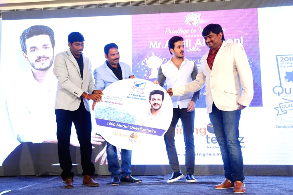 Akhil for winning teams quiz competition magazine and trophy launch.