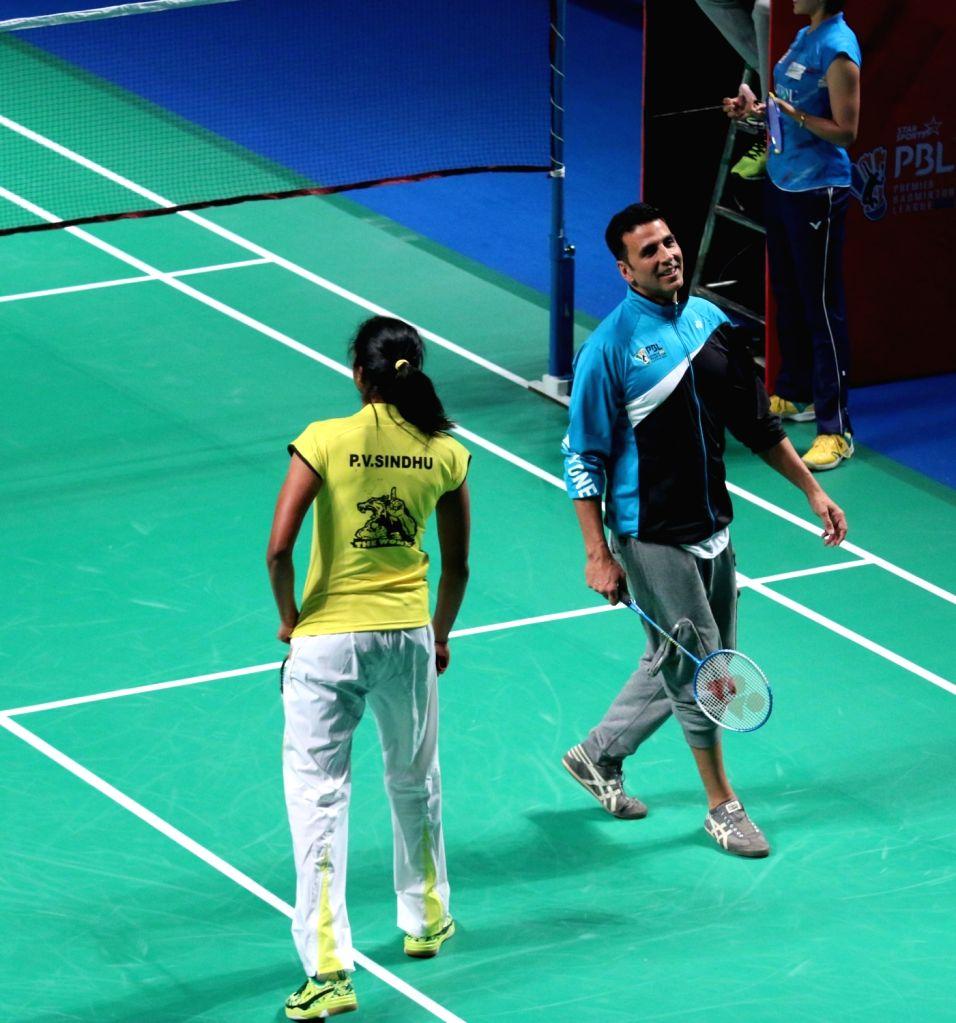 Akshay Kumar and P V Sindhu during a PBL exhibition match in New Delhi, on Jan 17, 2016. Mumbai Rockets won. - Akshay Kumar