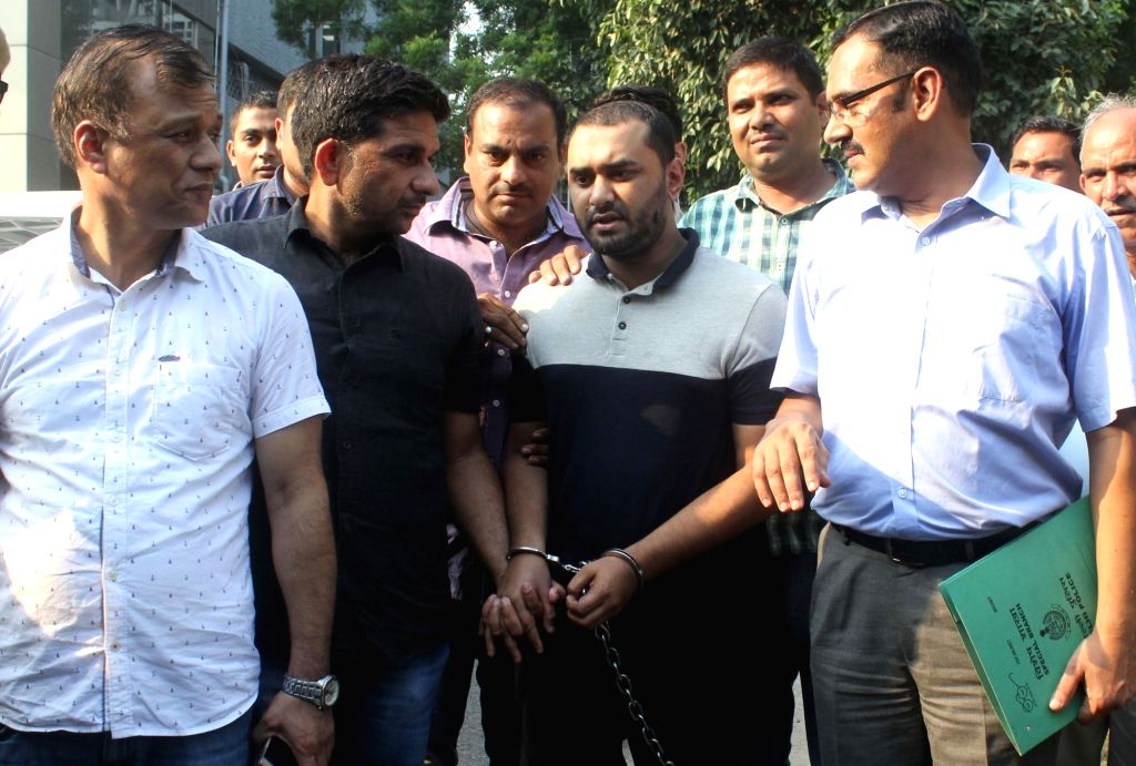 Al Qaeda terrorist Shumon Haq in the custody of Police's Special Cell officers at the Police headquarters in New Delhi on Sept 18, 2017. Haq who came with a mission to set up base Manipur ...