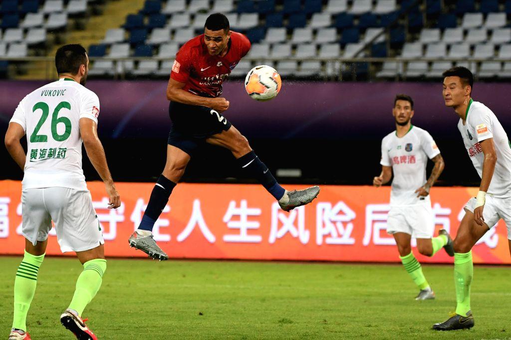 Alan Kardec (2nd L) of Chongqing Dangdai Lifan heads the ball during the 4th round match between Chongqing Dangdai Lifan and Qingdao Huanghai at the postponed 2020 ...
